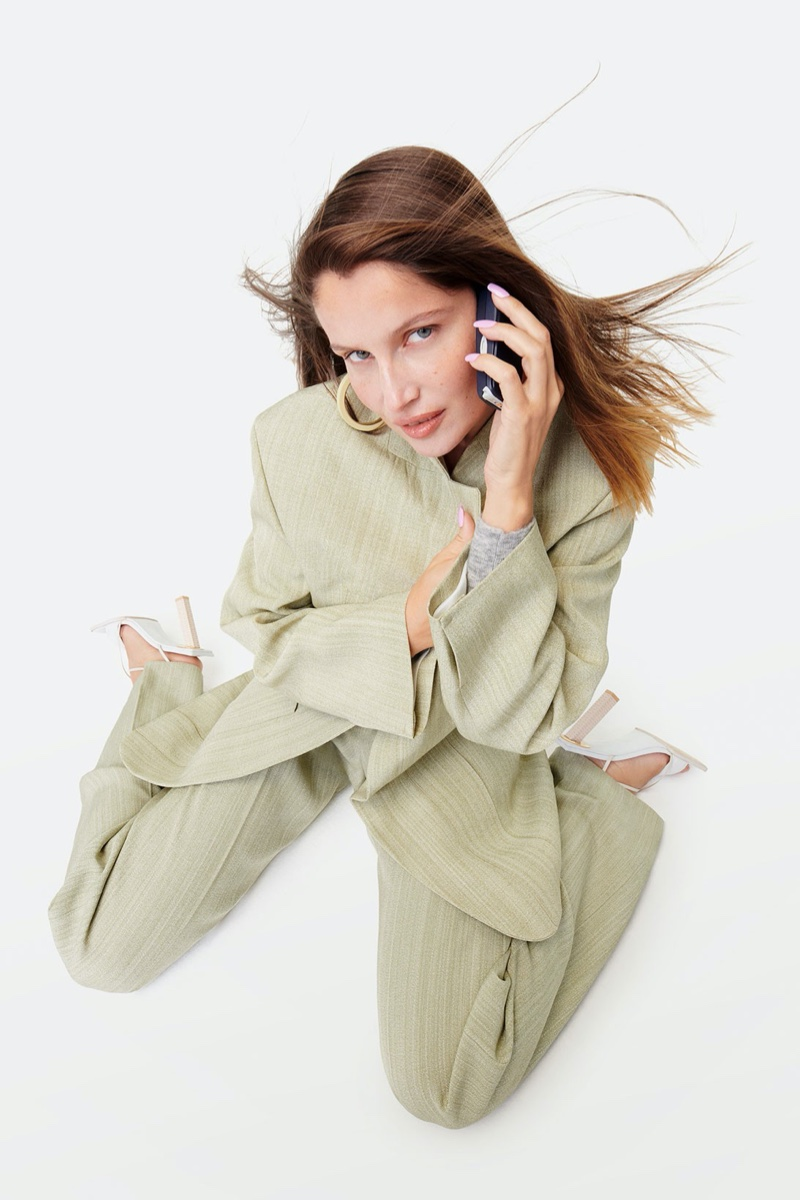 Laetitia Casta poses with 90s phone for Jacquemus fall-winter 2020 campaign.