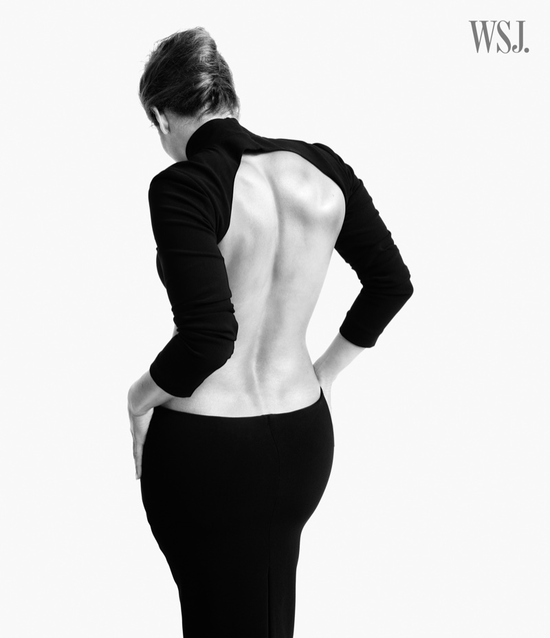 Flaunting her back, Jennifer Lopez poses in black and white.