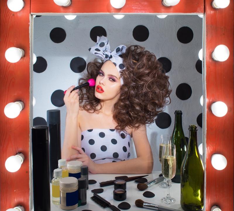 Model Applying Makeup Polka Dot Look Curly Hair Vanity Mirror
