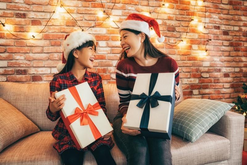 Mom Daughter Asian Holding Christmas Gifts Santa Hats
