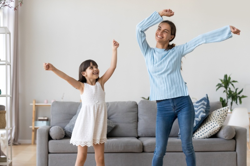 Mother Daughter Dancing Living Room Couch
