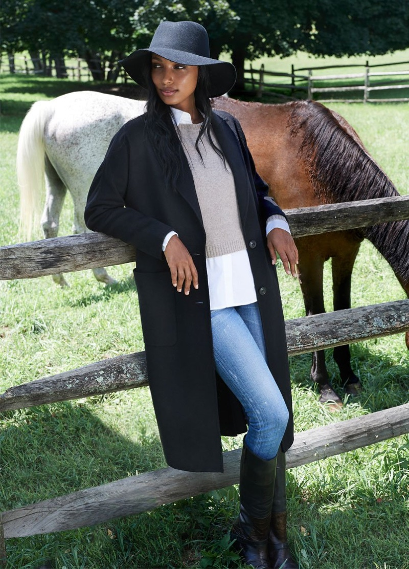 Jasmine Tookes poses next to horses in Naked Cashmere fall-winter 2020 campaign.