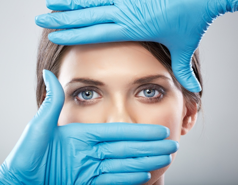 Plastic Surgeon's Hands Woman's Face Showing Eyes
