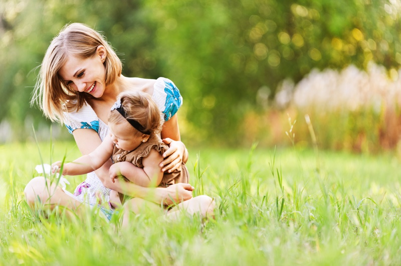 Smiling Mother Blonde Daughter Outdoors Grass Happy