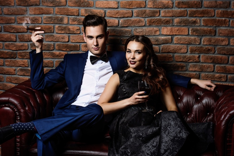 Stylish Couple Man Suit Woman Black Dress Cigar Wine Glass