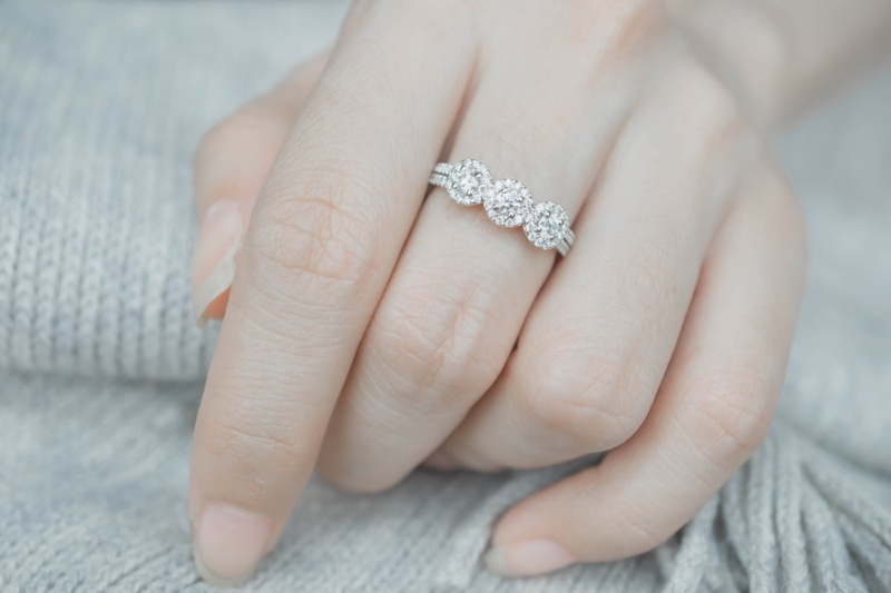 Three Stone Engagement Ring Model's Hand