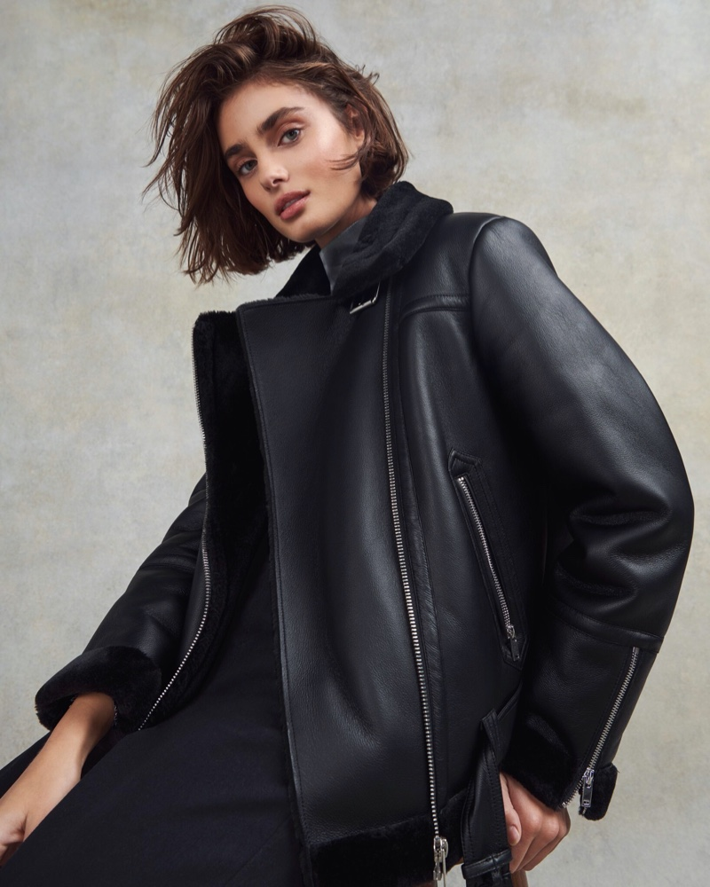Model Taylor Hill wears a leather jacket in Topshop Christmas 2020 campaign.