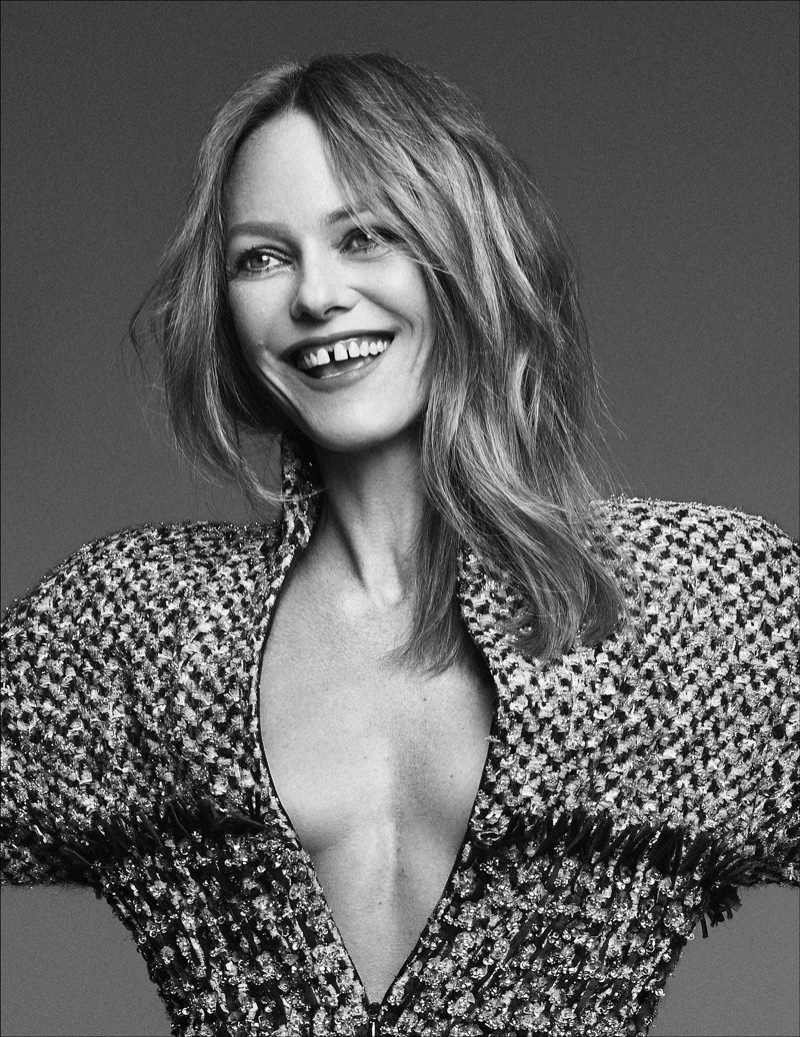 All smiles, Vanessa Paradis poses in black and white image.