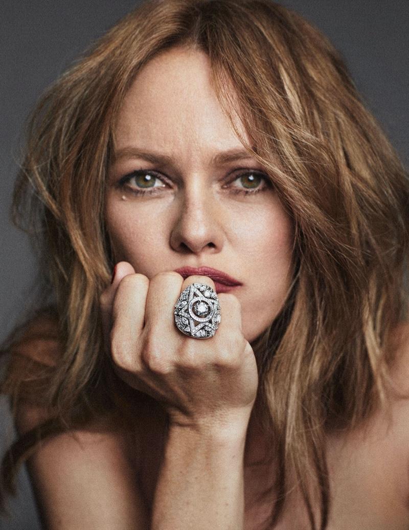 Wearing a ring, Vanessa Paradis poses in a closeup shot.
