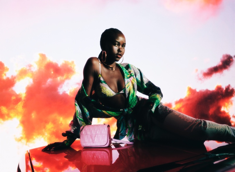 Adut Akech appears in Versace Holiday 2020 campaign.