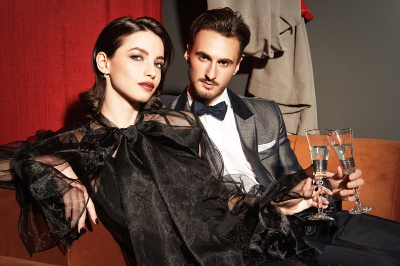 Well Dressed Couple Holding Drinks Elegant Style
