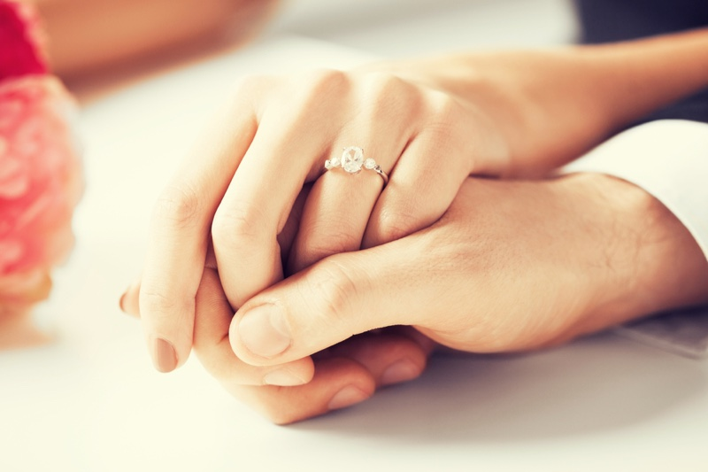 Woman Man Holding Hands Engagement Ring Side Stones