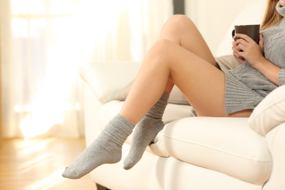 Woman Relaxing at Home with Legs Showing