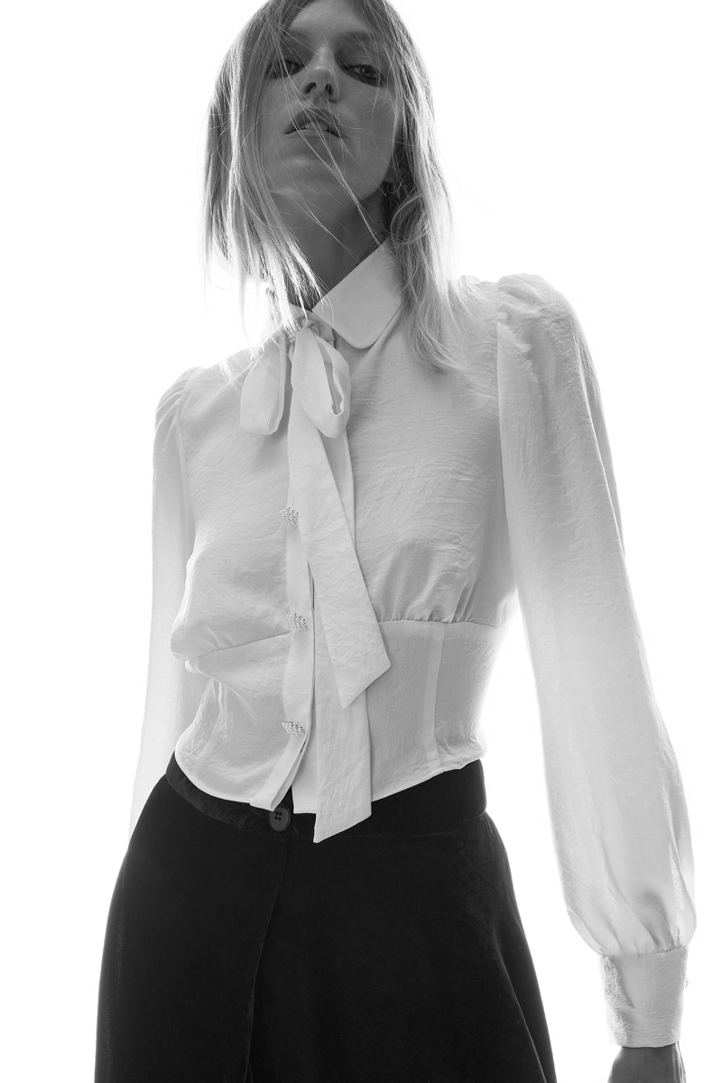Anja Rubik wears Zara shirt with bow.
