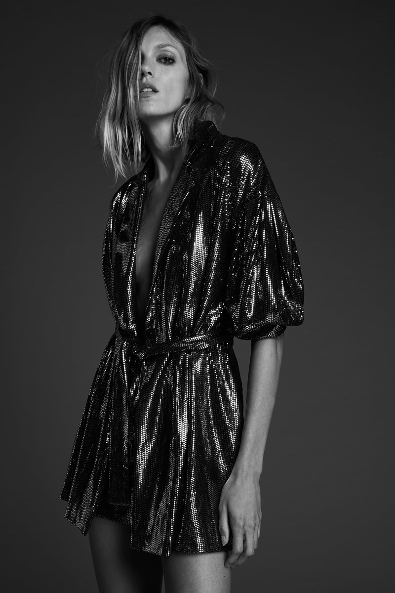 Anja Rubik poses in Zara belted sparkly jumpsuit.