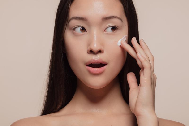 Asian Model Applying Face Cream