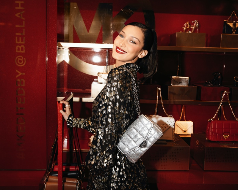 All smiles, Bella Hadid poses at MK Edited By event at Macy's Herald Square.