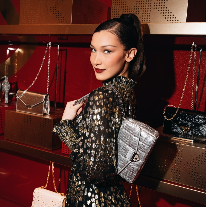 Wearing a party dress and bag, Bella Hadid poses at Michael Kors MK Edited by... event at Macy's Herald Square.