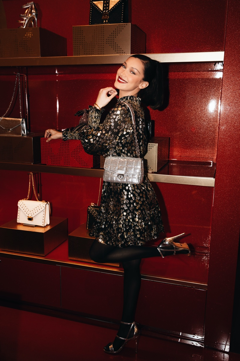 Celebrating holiday style, Bella Hadid poses at Michael Kors MK Edited By... event at Macy's Herald Square.
