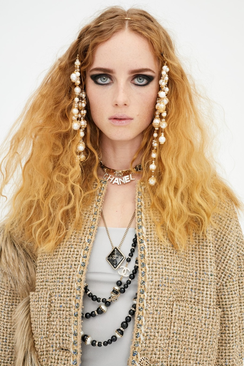 Chanel features layered jewelry in pre-fall 2021 collection.
