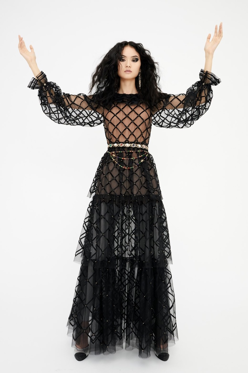 He Cong models tiered dress from Chanel's pre-fall 2021 collection.