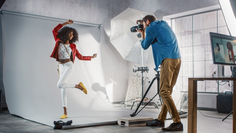 Fashion Photographer Capturing Black Model Camera Behind Scenes
