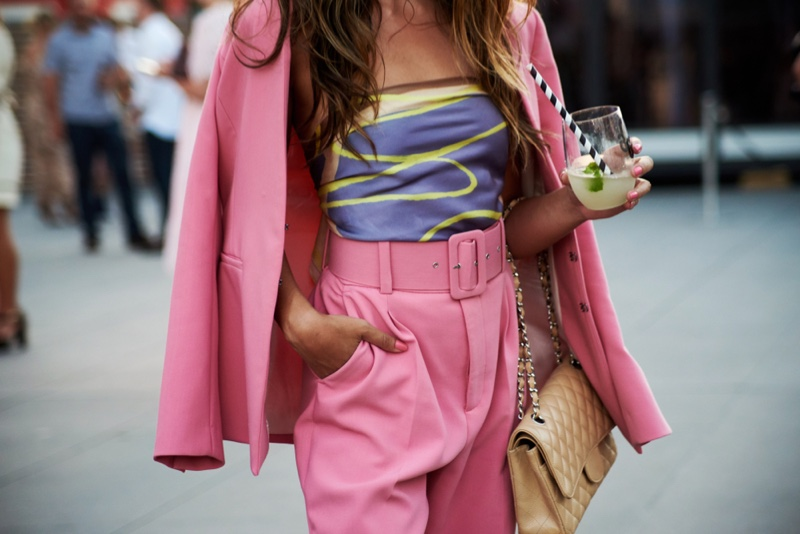 Fashion Show Goer Holding Drink Pink Suit Cropped