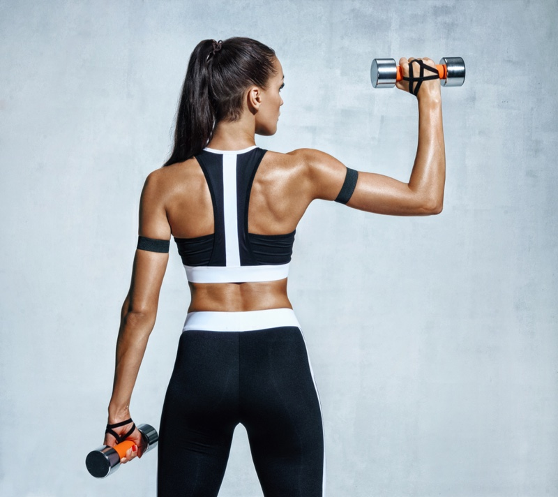 Fitness Model Weights Stylish Workout Outfit