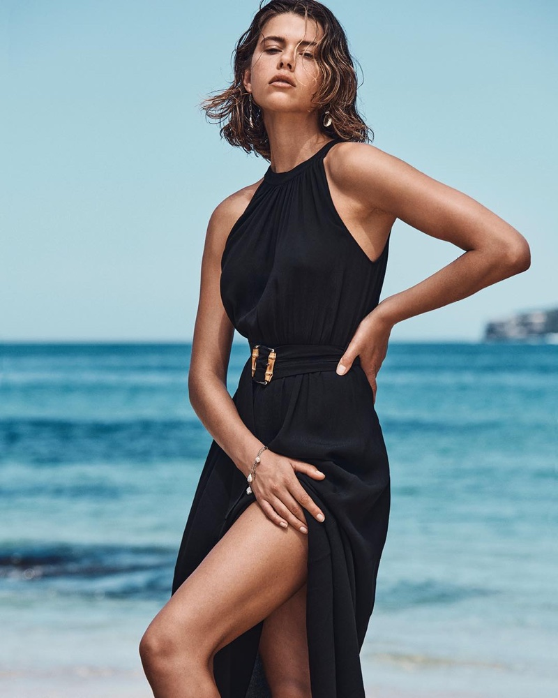 Posing at the beach, Georgia Fowler wears halterneck dress from Witchery.