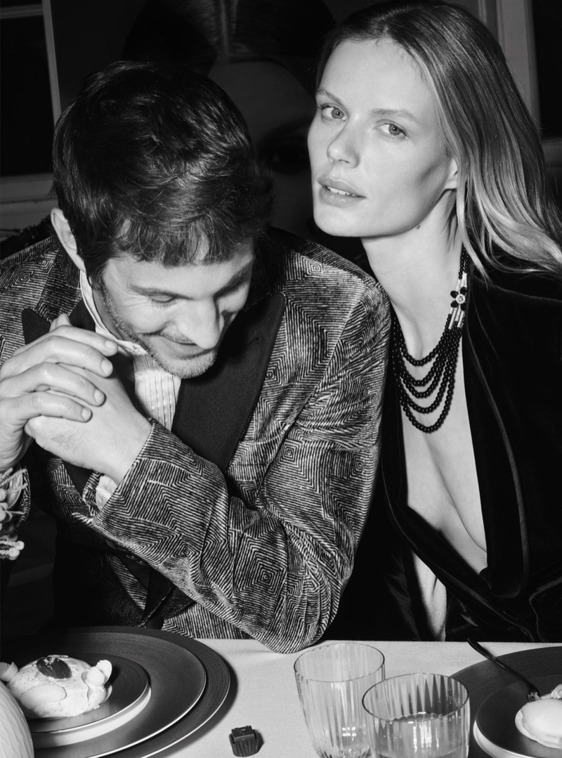 Kelly Rippy and Marlijn Hoek pose at a dinner setting for Giorgio Armani Holiday 2020 campaign.