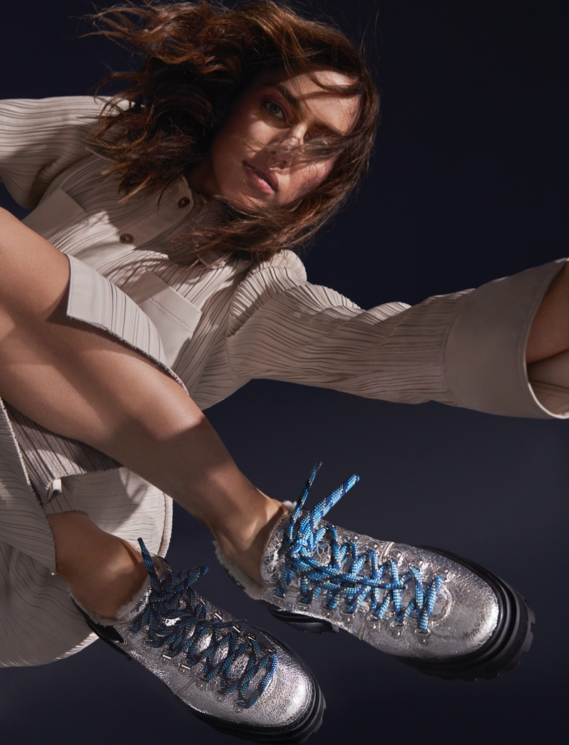 Irina Shayk models Schutz Lucille shearling bootie for the shoe brand's Holiday 2020 campaign.