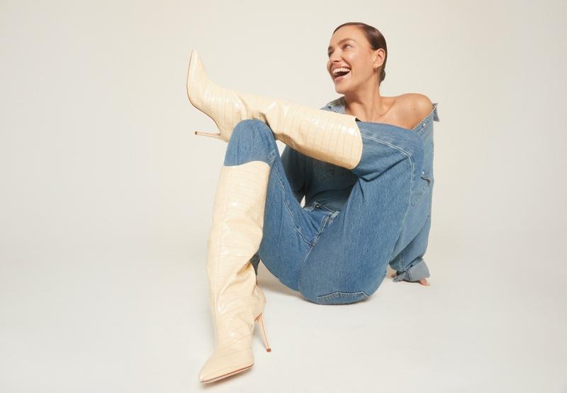Flashing a smile, Irina Shayk wears Schutz Maryana boot in eggshell.