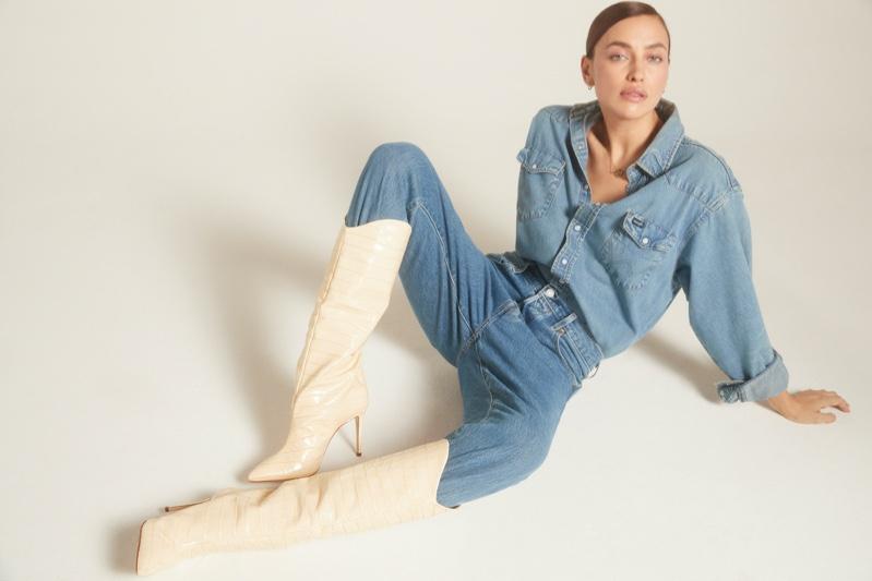 Rocking a denim on denim look, Irina Shayk fronts Schutz Holiday 2020 campaign.