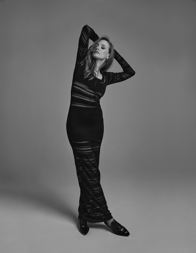 Photographed in black and white, Jessica Chastain strikes a pose in a long-sleeve dress. Photo: David Roemer