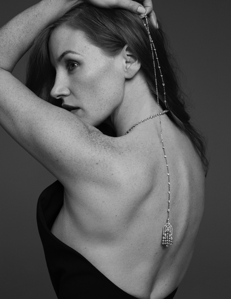 Showing off her back, Jessica Chastain poses in Celine halter neck dress with Piaget jewelry. Photo: David Roemer
