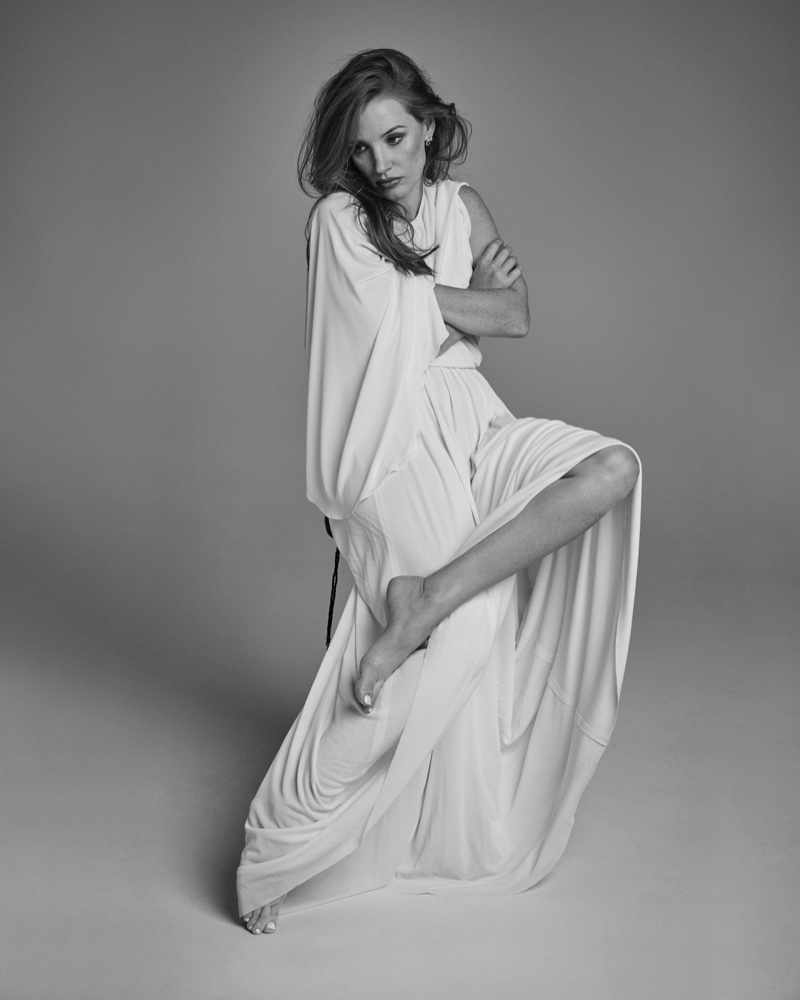 Jessica Chastain poses in draped Dior dress with Piaget earrings. Photo: David Roemer