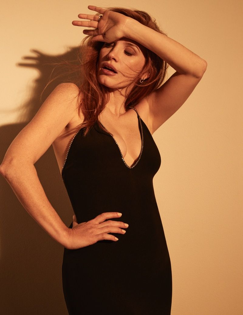 Dressed in black, Jessica Chastain wears Celine dress with Piaget earrings. Photo: David Roemer