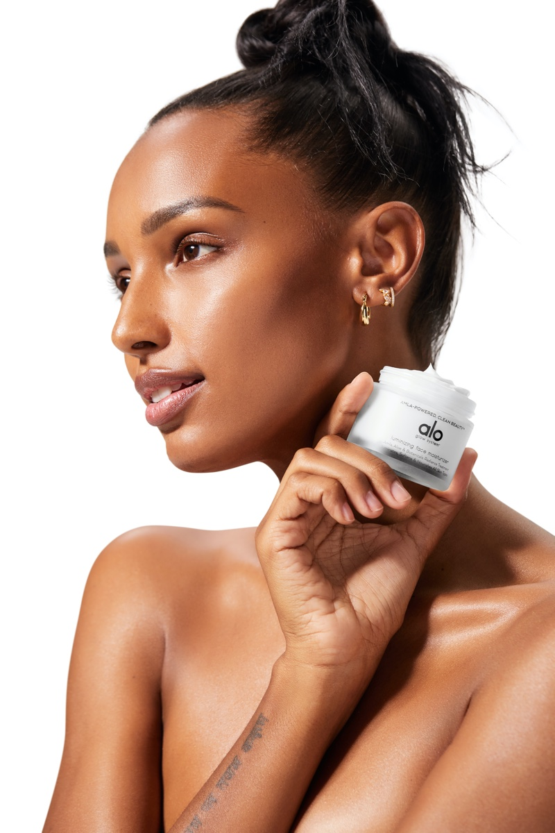 Model Jasmine Tookes poses with Alo Yoga's new skincare line, The Alo Glow System.