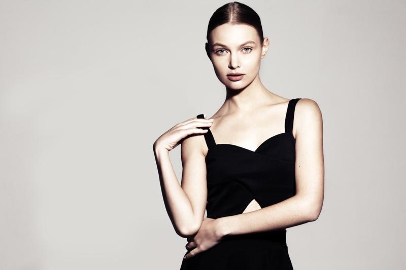 Model Form-Fitting Black Dress Neutral Background