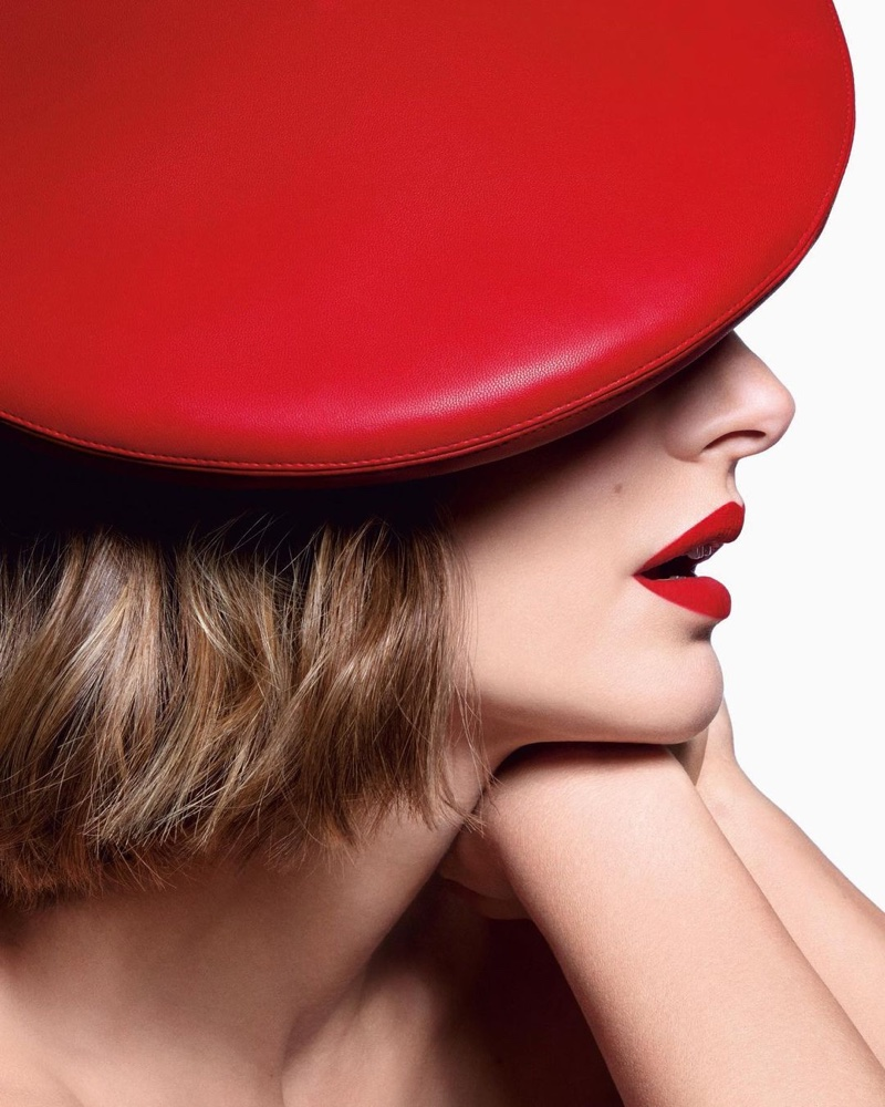 Wearing vegan accessories, actress Natalie Portman fronts Dior Rouge Dior 2021 lipstick campaign.