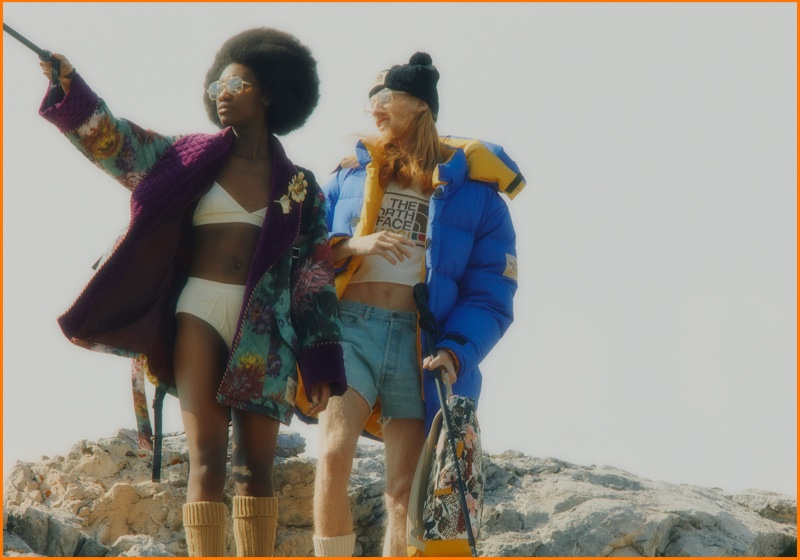 Models pose in The Alps for The North Face x Gucci campaign.