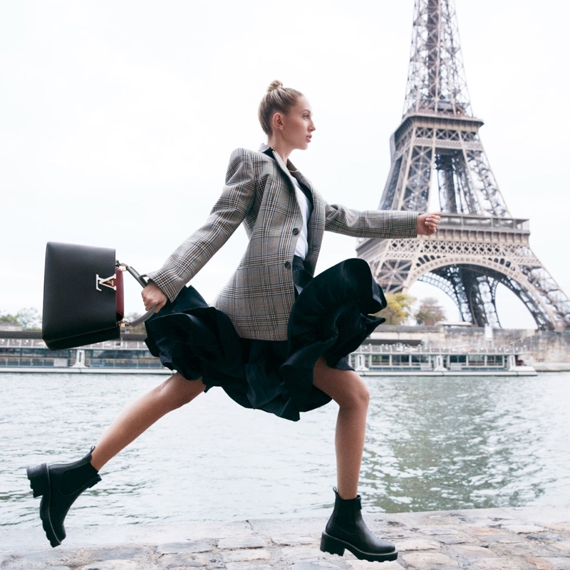 Posing near the Eiffel Tower, Princess Olympia Greece fronts Louis Vuitton Capucines bag campaign.