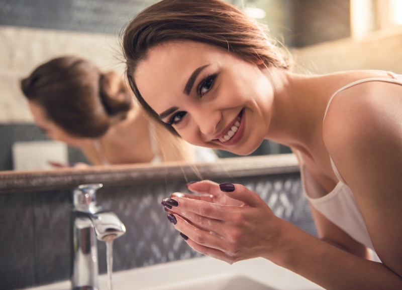 Smiling Woman Washing Hands