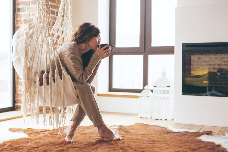 Woman Drinking Electric Fireplace Seat