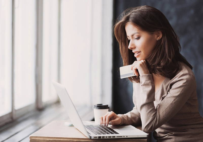 Attractive Woman Shopping Online Credit Card Laptop