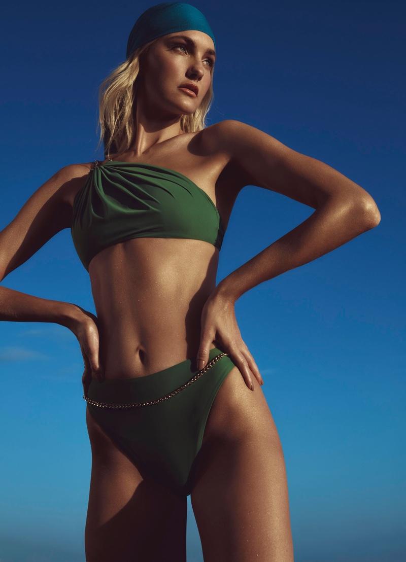 Model Caroline Trentini wears green swimsuit look from Agua de Coco.