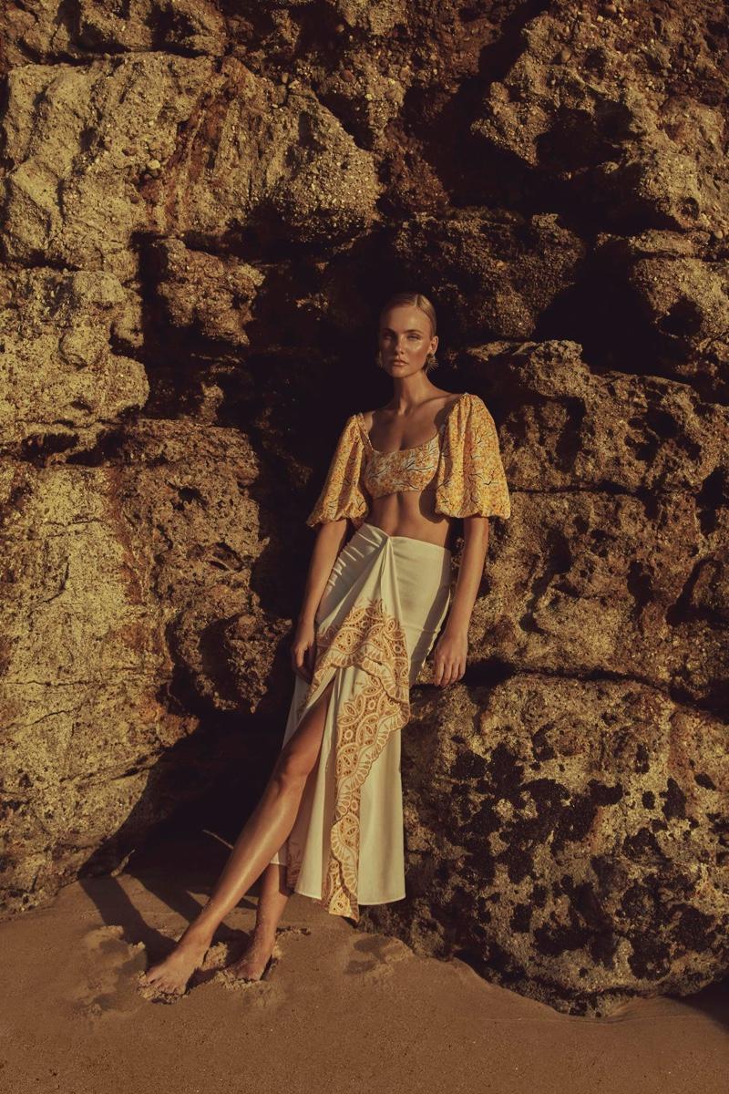 Posing at the beach, Caroline Trentini models Agua de Coco Cerrado collection.