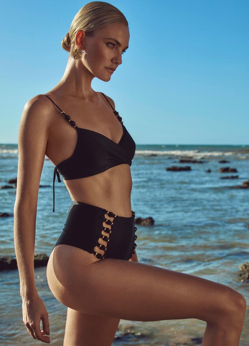 Rocking a black bikini, Caroline Trentini poses in Agua de Coco spring-summer 2021 campaign.
