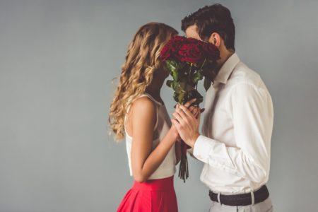 Couple Behind Flowers Romantic Concept