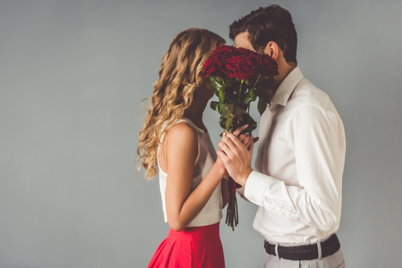Couple Behind Flowers Romantic Concept